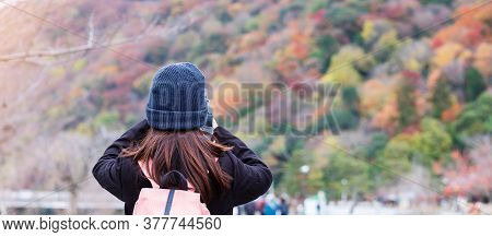 Happy Woman Tourist Taking Photo Colorful Leaves Mountains By Camera In Arashiyama, Young Asian Trav