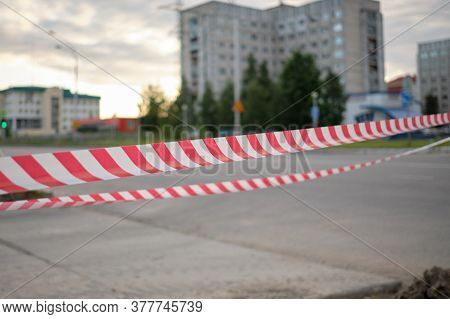 Red And White Striped Warning About Danger And Limited Access Tape Tape. Red And White Striped Stret