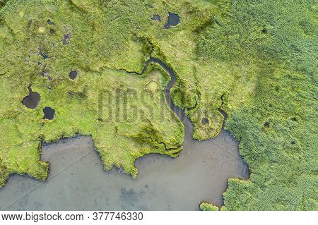 Drone Top Down Bird's Eye View Landscape Image Of Tidal Wetlands In Christchurch Harbour On England'