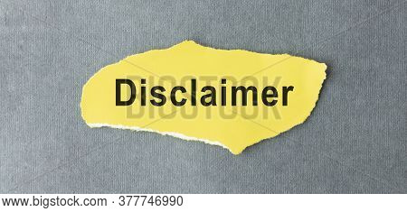 Disclaimer Text Written On A Yellow Piece Of Paper.