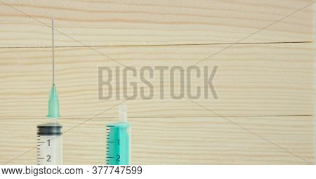 Syringes On A Wooden Background. Flu Injection. Disease Injection