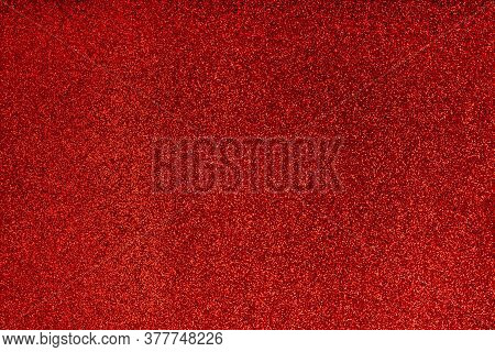 Abstract Red Vibrant Festive Defocused Backdrop. Festive Glitter Christmas Background. Glittering Su