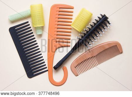 Green Yellow Curlers, Combs, Hair Brush. Hair Care Concept. Pastel Background. Top View
