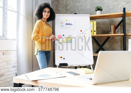 Online Presentation, Webinar, Online Meeting. A Young African American Woman Speaks To The Audience