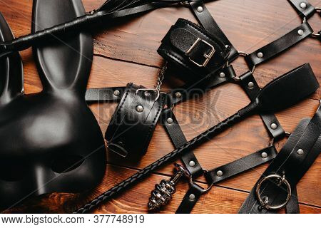 Set Of Erotic Toys For Bdsm Sex. Lash, Handcuffs, Leather Belt, Mask