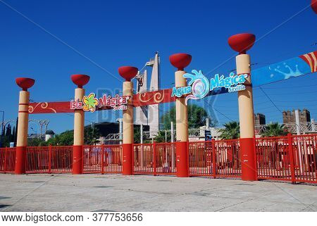 SEVILLE, SPAIN - APRIL 3, 2019: The entrance gates to the Isla Magica theme park. Built on the site of the 1992 Exposition, the park opened in 1997.