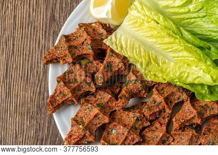 Cig Kofte (raw Meatball In Turkish) With Lettuce And Lemon. Turkish Local Raw Food Concept.