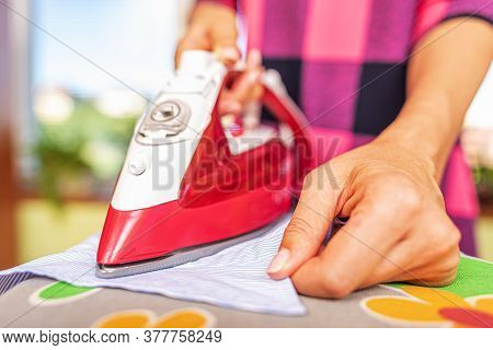 Woman Ironing With Iron. Household Ironing Of Linen.