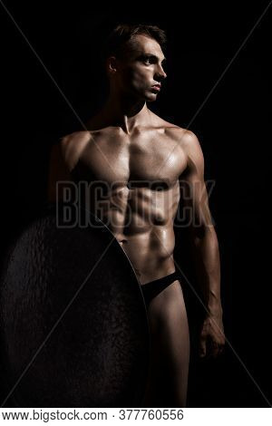 Front View Of Young Fit Strong Warrior With Perfect Muscular Body. Tensed Athlete In Underwear Looki