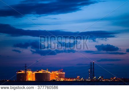 Oil And Gas Refinery Storage In Oil Refinery Petrochemical Industry Estate, Factory With Evening, Ga