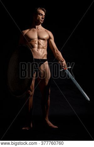 Front View Of Young Fit Strong Warrior With Perfect Muscular Body. Muscular Athlete In Underwear Lok