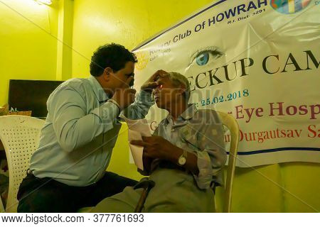 Kolkata, West Bengal, India - 25th February 2018 : Indian Male Doctor Testing Eye Of An Indian Male
