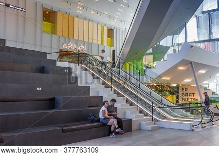 Groningen, Netherlands - July 13, 2020: Tourists Sitting In The Entry Lobby Of The Groninger Forum