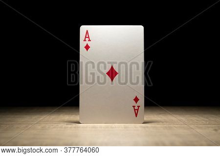 Brecht, Belgium - 29 May 2020: A Portrait Of The Ace Of Diamonds Standing Up In The Spotlight On A W