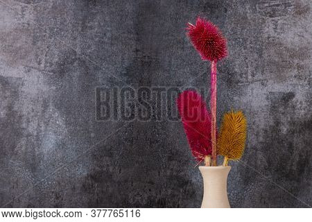 Dried Colorful Flowers Placed In Vase With Gray Background