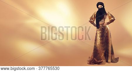 Oriental beauty woman. Full length portrait of a beautiful arabian woman in traditional dress, with traditional oriental make-up and black hijab. Make-up and cosmetics. Studio shot.