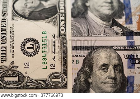 One Hundred Dollars And One Dollar Bills. Closeup Of Benjamin Franklin And George Washington . Us Do