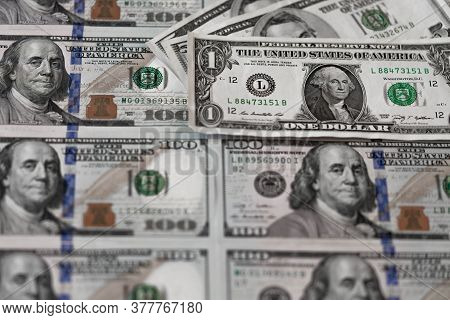 One Hundred Dollars And One Dollar Bills. Benjamin Franklin. Us Dollars Background. Closeup Of A Lot