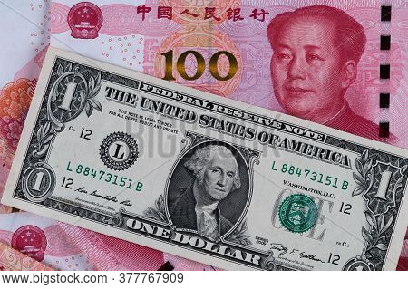 One Dollar And One Hundred Chinese Renminbi Rmb Bills. Cny Background. Closeup Of Benjamin Franklin