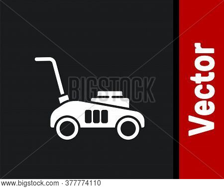 White Lawn Mower Icon Isolated On Black Background. Lawn Mower Cutting Grass. Vector Illustration