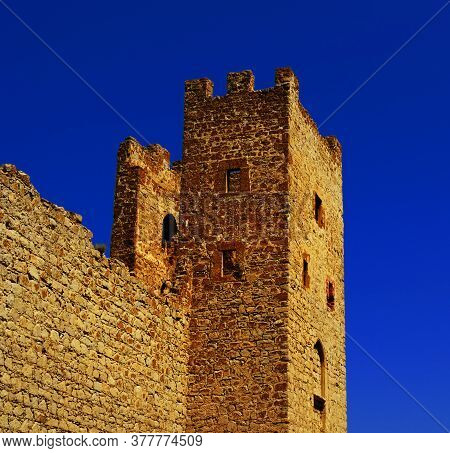 Architectural Monument - The Tower Of St. Clement At Sunset In The Genoese Fortress Kafa In Feodosia