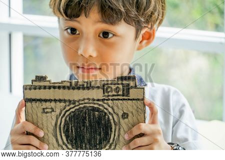 Cute Little Kid Boy Holding Paper Camera. Junior Photographer. Child, Kids, Learning Concept.