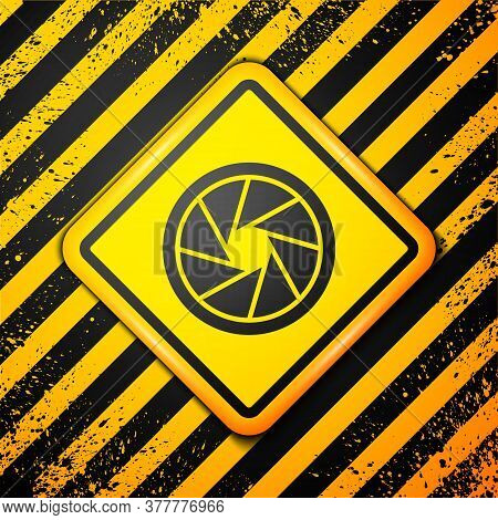 Black Camera Shutter Icon Isolated On Yellow Background. Warning Sign. Vector Illustration