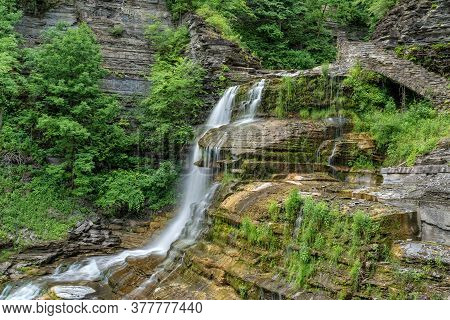 Side View Of Lucifer Falls At The Robert H. Treman State Park In New York
