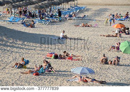 Pilar De La Horadada, Spain - September 21, 2018:people Relax On A Sandy Beach In Torre De La Horada