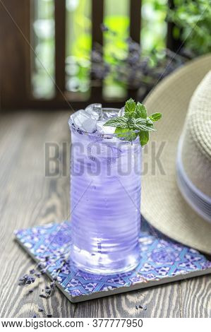 Lavender Lemonade And Ice Cubes On A Wooden Table. Summer Drink, Iced Tea.