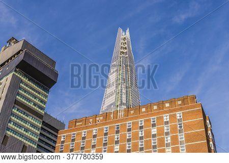 July 2020. London. The Shard Amongst Brick Buildings In London England