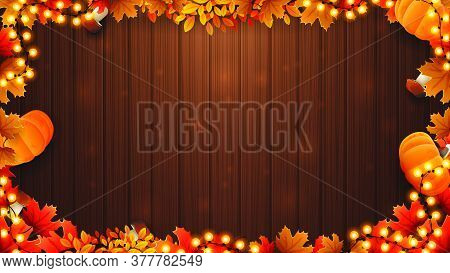 Autumn Background With Brown Wooden Wall And Frame Made Of Autumn Leafs And Autumn Harvest Elements