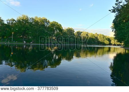 Reflections Of Trees And Clouds On Lake Water, La Fontaine Park, Montreal, Qc, Canada