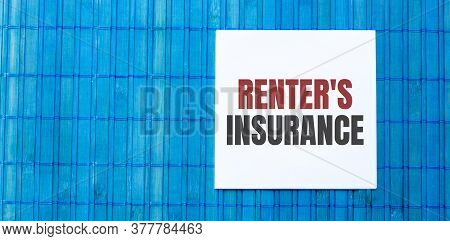 Blank Note Pad With Renters Insurance Text On Blue Wooden Background