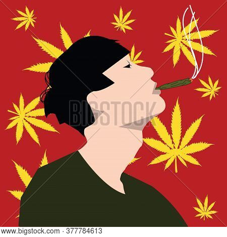 A Man Smokes Hemp Against The Background Of Hemp Leaves.