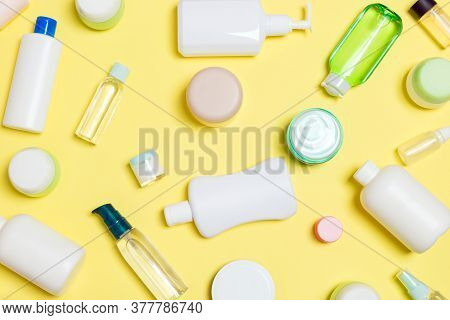 Group Of Plastic Bodycare Bottle Flat Lay Composition With Cosmetic Products On Yellow Background Em