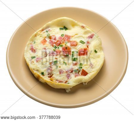 Omelet With Tomatoes And Green Onions On A Plate Isolated On White Background.omelet With Vegetables