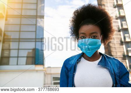 Health, Pandemic And Safety Concept - Young American African Woman With Black Power Hair, Dressed Ca
