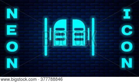 Glowing Neon Old Western Swinging Saloon Door Icon Isolated On Brick Wall Background. Vector Illustr