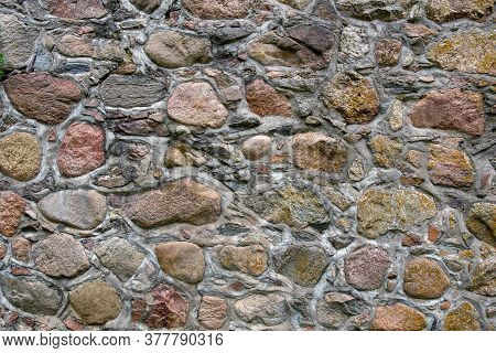 Stone Wall Texture Background. Fragment Of A Massive Wall Of An Ancient Building.