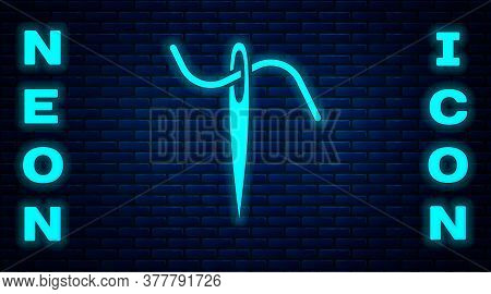Glowing Neon Needle For Sewing With Thread Icon Isolated On Brick Wall Background. Tailor Symbol. Te