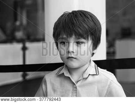 Black And White Lonely Kid Standing Alone With Sad Face,  Upset Child Looking Out Deep In Through,a