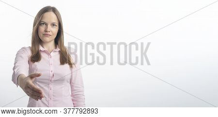 Serious And Friendly Young Caucasian Woman Reaching Extending To Shake Hands. Shaking Hands Concept,