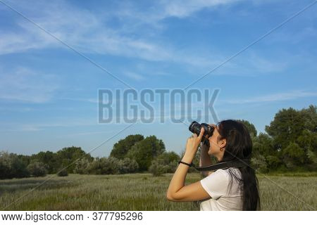 Young Woman Photographs The Blue Sky With A Slr Camera. Copy Space, Photography Landscape Concept.