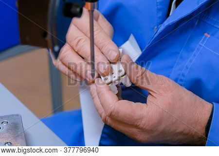 Blind Man Assembler, Electrician Hands Assembling Electric Socket At Fabric. Repair, Production, Han