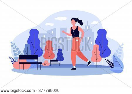 Jogger Wearing Headphones Running Down Pathway Outdoors. Woman Training In City Park In Morning. Ill