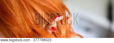 Close-up Of Female Touching Red Hair. Woman With Beautiful Fresh Manicure. Pretty Curls On Head. Goo