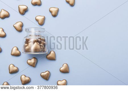 Golden Hearts Near And Inside The Bottle. Concept Of Alms, Charity, Fundraising, Donation. Copy Spac