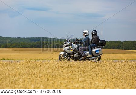 Vendeuvre-sur-barse, France - 6 July, 2017: Reporters On A Bike Pass Through A Region Of Wheat Field