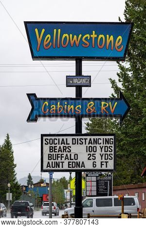 West Yellowstone, Montana - June 28, 2020: Sign At The Yellowstone Cabins And Rv Park To Remind Abou